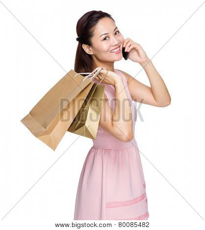 Woman hold with shopping bag and talk to cellphone