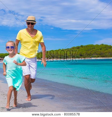 Young father and little daughter during tropical beach vacation
