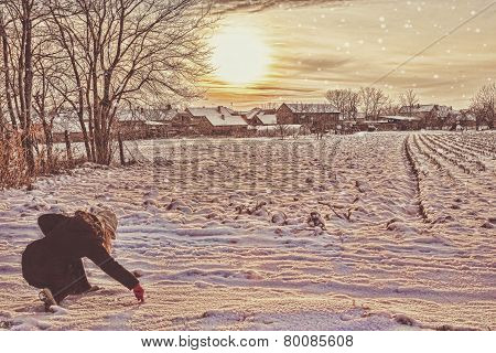 Woman In Winter Clothes In Snow Drawing With Finger