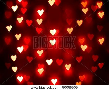 a nice background with unfocussed lights blurred into the shape of hearts - holidays like valentine's day or wedding announcements or romantic cards toned with a retro vintage instagram filter effect