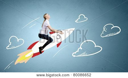 Young girl flying on rocket against drawn background