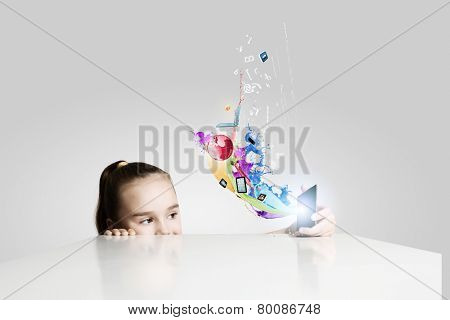 Little cute girl and colorful paint splashes