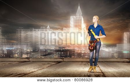 Close up of woman builder with ruler in hands