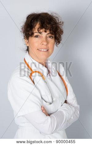 Nice Female Doctor Or Nurse With Arms Crossed