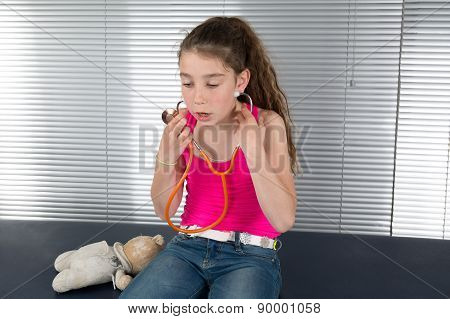 Cute Young Girl Looks Like A Doctor With A Stethoscope