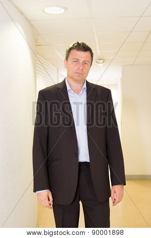 Good Looking Business Man Alone At His Office