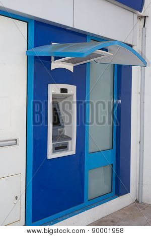 A Blue Atm Machine With Nobody In Front