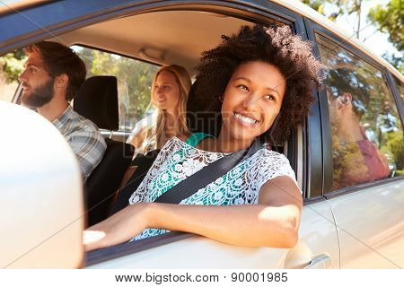 Group Of Friends In Car On Road Trip Together