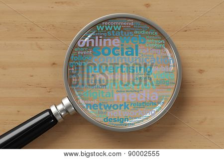 Online marketing tag cloud concept under a magnifying glass (3D Rendering)