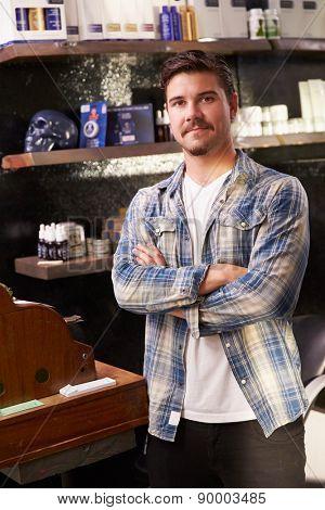 Portrait Of Male Barber Standing By Cash Register