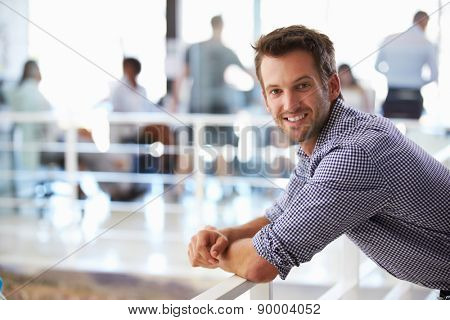 Portrait of man in office smiling