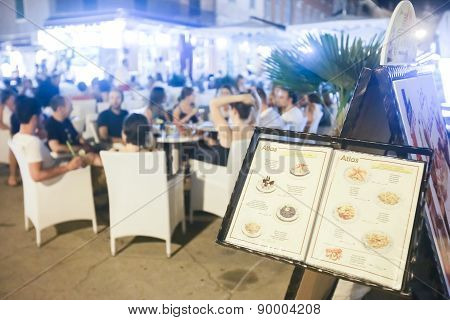 Tourist Menu Displayed In Front Of Restaurant On Promenade