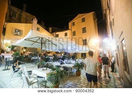 Tourists Sitting In Restaurant