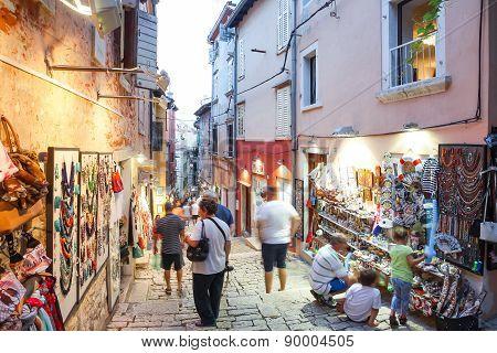 Tourists Walking Next To Displayed Souvenirs In Rovinj