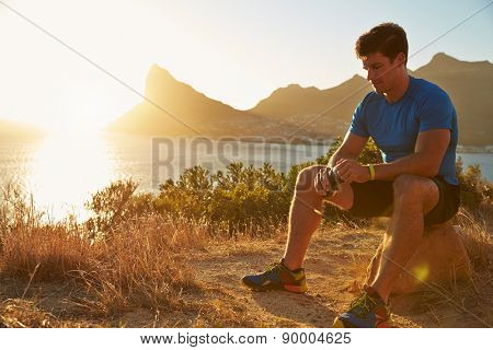 Young man resting after jogging