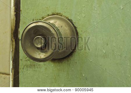 Old Door Handle And Water Drop