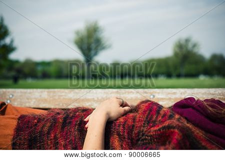 Woman Lying On A Bench Relaxing