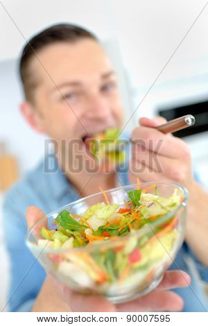 Man eating a healthy salad