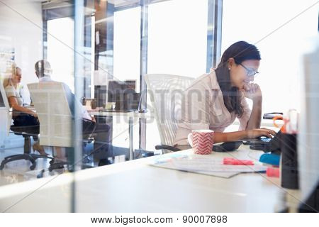 Woman working at computer in an office