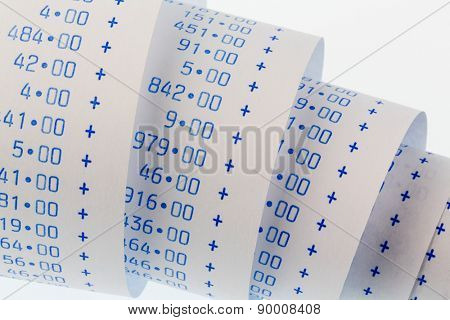 the computing strips of a calculator on a white background. symbolic photo for controlling, accounting, taxation and finance