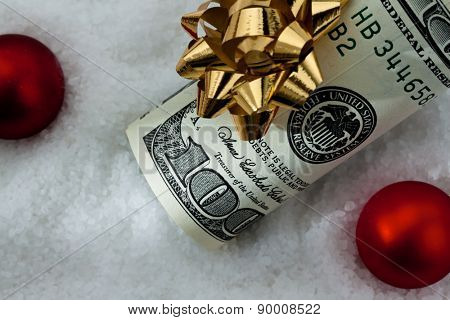 dollar bills with a bow as a gift of money