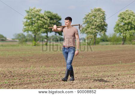 Farmer With Hoe