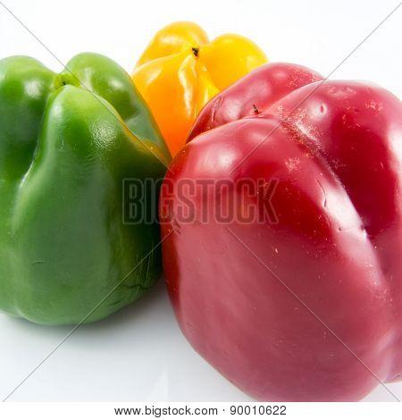 Three color fresh capsicum on white