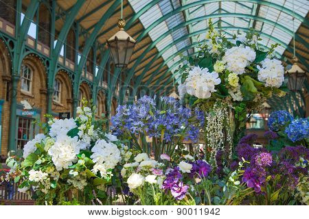 LONDON, UK - 22 JULY, 2014: Flower shop Covent Garden market, one of the main tourist attractions in