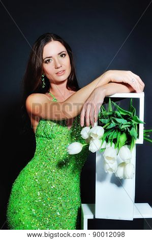 Young Lady With A Bouquet Of Tulips On Dark Background