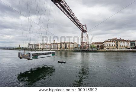 Ultra Wide view closeup of the Bizkaia suspension bridge and boat