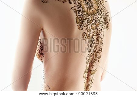 Art of mehndi. Topless model posing back to camera