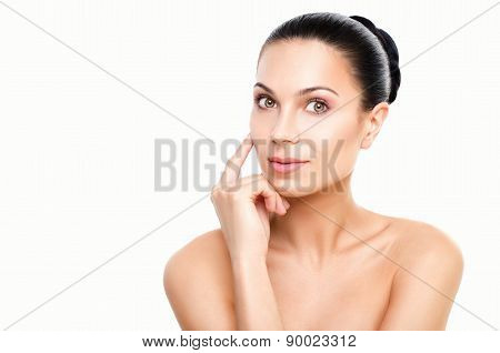 Beautiful Young Woman With Fresh Clean Skin - Touching Finger Face . Isolated On White.