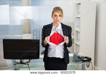 Businesswoman Showing Superhero Costume