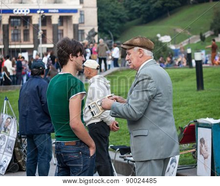 Ukraine, Kiev - September 11,2013: Elderly Man On The Independence Square Earns A Pretext To Passers