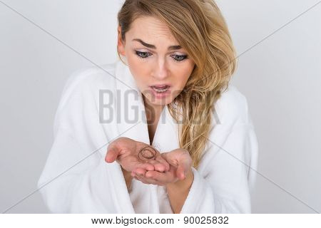 Worried Woman Holding Loss Hair