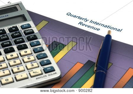 Business Report With Calculator And Pen