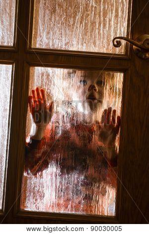 Child Behind Door Of Glass