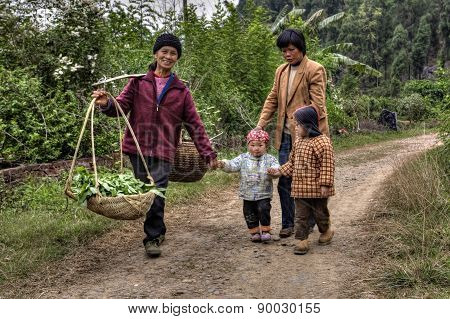 Villagers In China, Women With Children, Are On Country Road.