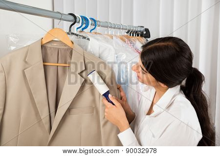 Cleaner In Laundry Shop With Adhesive Roller