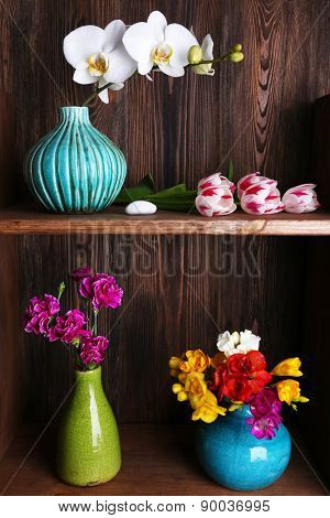 Fresh spring flowers on wooden background