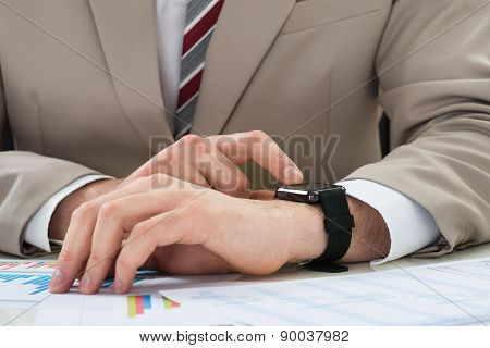 Businessman With Graph And Smartwatch