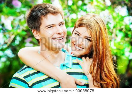 Beautiful young couple in love in a summer park. Love concept. Happiness.