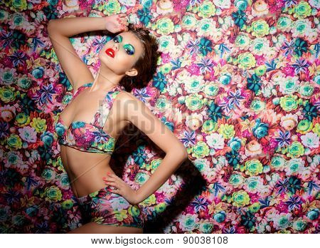 Portrait of a sexual woman in lingerie over bright floral background. Beauty, fashion.