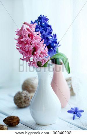 Beautiful hyacinth flowers on windowsill background