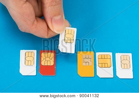 Person Hand With Sim Cards