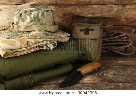 Hiking gear on wooden background poster