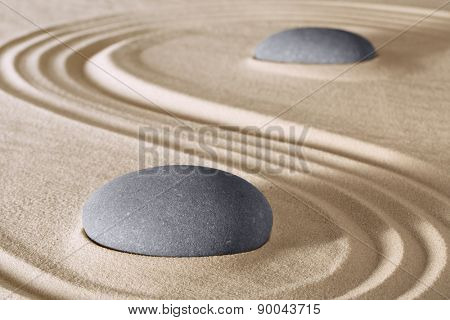 zen stones meditation and relaxation in Japanese zen garden. Stone and sand lines pattern background