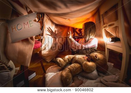 Girl Made Theater Of Shadows In Self-made House At Bedroom