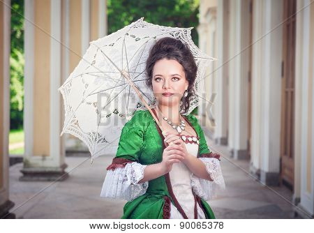 Beautiful Young Woman In Green Medieval Dress With Umbrella