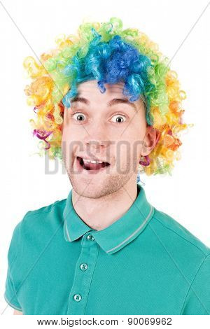 Portrait of a man in a clown wig. guy silly smiles. Isolated over white background